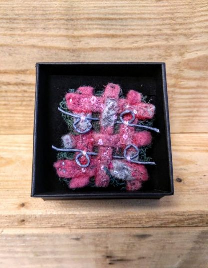 pink and grey woven brooch