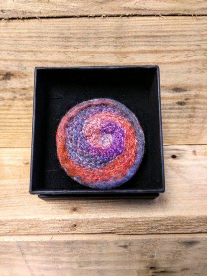 rust and purple swirl brooch
